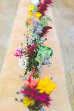 Rustic farmers market flowers and mason jars