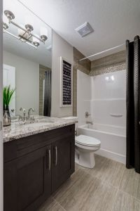 Ideas to update a fibreglass shower and tub surround with accent tile by Stepper Homes