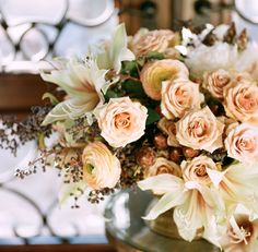 Peach, rust, white, sage, lavender, roses, lilies.   YES!  Romantic floral design for an elegant, garden inspired wedding.  found on OnceWed.  Get Inspired: kellycameron.net