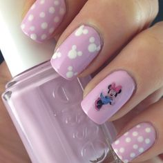 This cute nail art uses nude and lavender polish, plus nail art stickers. Perfect for the kids-at-heart and the Disney lovers.