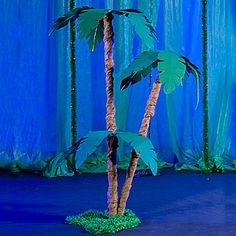 Save on this striking gossamer palm tree for your tropical party or event.