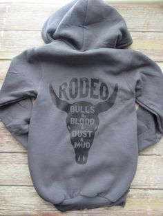 Country sweatshirt/ Zip Hoodie/ Rodeo/ Bulls and Blood and Dust and Mud by…