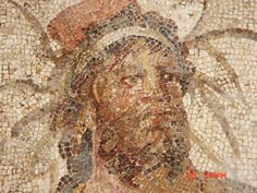 MAGNIFICENT ROMAN MOSAIC REPRESENTING THE EUPHRATES. 2nd century AD. ~155 x 155 cm. ~160 kg. A very rare subject matter representing the river Euphrates holding grain ears signifying the river's significance to the grain harvest, with identifying inscription. Complete and original save for slight restoration of white tesserae above the head. Provenance: Ex. Christie's sale number 2364 on December 9, 2010