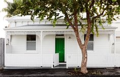 Love the punch of green + all white + cleverly, blending to the tree framing the house. Philip Messenger and Susannah Lempriere — The Design Files Best Exterior Paint, Exterior Paint Colors, Exterior House Colors, Exterior Design, Weatherboard House, Queenslander, Green Front Doors, Beautiful Front Doors, Cottage Exterior