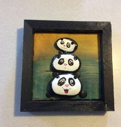 Painted garden river rocks pandas on wood wth handmade frame . 7x7 with sawtooth hanger on the back. Each hand picked rock out of my garden is hand painted and mounted onto a painted board then we make a rustic wood frame. Each of my pieces is one of a kind originals and lovingly assembled by my husband and myself. Why Pandas? Well, arent they just the cutest !!! I hope my art brings as much joy to you as it was for my to make.