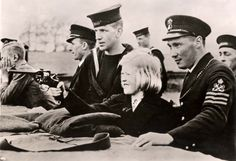 Plymouth, England, March 1939, A girl shooting a Webley revolver under the instruction of British sailors. via reddit