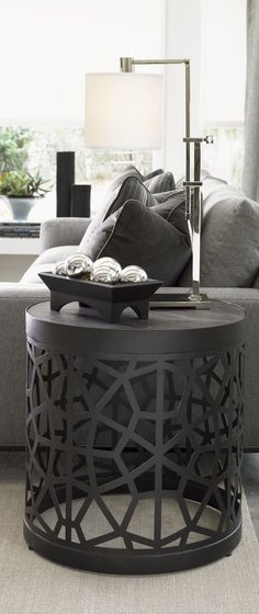 A unique side table like this is a great way to liven up a modern living room