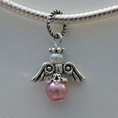 Pink Pearl Guardian Angel Charm Bead for fits Pandora and Brighton Bracelets. $4.99, via Etsy.