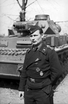 Feldwebel ( sergeant ) of Panzertruppe and his Panzer IV ( early version, short barrel 75 mm cannon). France  21 June 1940