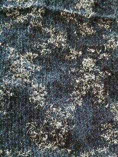 Like Karabella Gossamer yarn. THis is Louisa Harding Simonetta and the tinsel did loose argyle-ish pooling. Ravelry: janicemurphy's MIL black and silver wrap/scarf