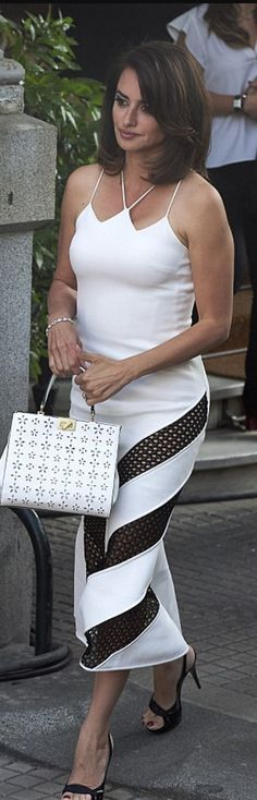 Who made  Penelope Cruz's black and white stripe lace dress?