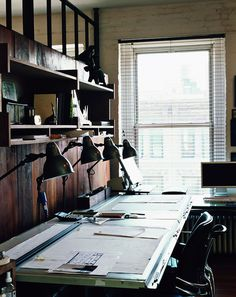 drafting tables with venetian blinds on window