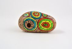Hand painted stone. Home decor. Painted rock art. Unique gift. Hand painted beach stone with natural hole. This stone I found by the coast of Baltic Sea.