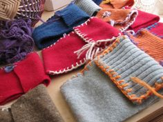 sweet little pouches fashioned from recycled sweaters and other fabric