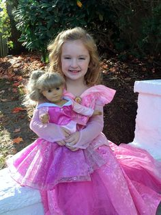 These dresses are absolutely stunning! The attention to detail is remarkable.  Get one or a few these are sure to be a hit! They are the perfect gift.  Any little princess will love playing dress up and then matching her doll!StylesThe Ice PrincessThe Warm Hearted PrincessSchool GirlSanta DressLittle Red Riding Hood InspiredCinderella Inspired(Comes with Purse, Shoes)The Yellow BeautyThe Sleeping BeautyFairest PrincessThese fit any standard 18' doll and American Girl Dolls!