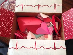 """Made this """"heart attack"""" box for friend for valentines day. She appreciates my nerd humor. ;) We packed it full of heart candy and valentines cookies and used paper hearts as packing filler. The painted EKG topped it all off."""