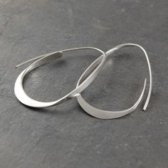 A unique take on the traditional hoop, these Silver Curl Hoop Earrings will definitely get noticed. Gradually tapered, these hoops look wonderful and are easy to wear, too! These Silver Curl Hoop Earrings are also available in a gold finish. #Otisjaxon #J