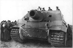 Lots of top officer staff inspecting a new prototype example of the Sturmtiger assault tank