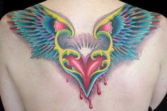 color tattoo of a flying bleeding heart. The wings look a bit like ...