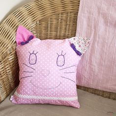 A decorative patchwork pillowcase. The pillow forms the head of a friendly cat with purple lace bows on the ears. It is the perfect bedroom decoration and this soft kitty can become a kid's best friend. Patchwork Pillow, Pillow Cases, Sewing Projects, Cotton Fabric, Throw Pillows, Handmade, Vintage, Pink, Toss Pillows