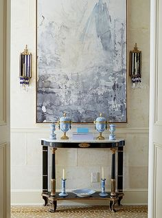 Love the mix of gilded French antiques and Wedgewood ceramics paired with the abstract modern art in this eclectic entryway.