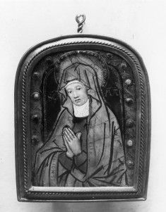 """Enameled pendant on copper, gilt metal frame. 1520s. Nardon Pénicaud (French, 1470-1542/3) (Artist)  The edge of the mantle was originally inscribed in gilding with words of the Ave Maria prayer, now effaced. Her sky-blue nimbus has a jeweled edge. The background is green, inscribed in faded gilt letters SCA MA and surrounded by a scalloped line in gilding, also very faded. The purple border following the rounded top is studded with raised """"jewels"""" over spangles of foil. Acsn 44.158"""