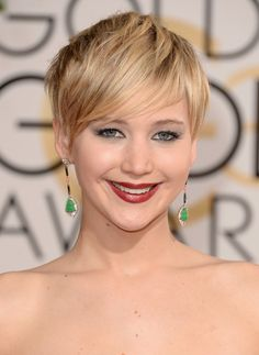 Jennifer Lawrence's pixie cut framed her face beautifully, while her silver eye shadow and berry lip upped the high-fashion factor. #GoldenGlobes