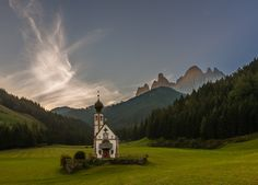 Small Orthodox chapel in a pastoral mountain valley.