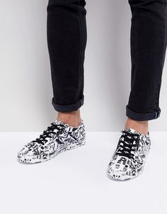 fe9529d835 DESIGN lace up trainers with graffiti print