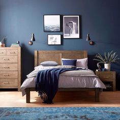 The Corniche bedroom range is crafted from dark American oak. Contrast with dark blue walls for a bold and beautiful look. The Corniche bedroom range is crafted from dark American oak. Contrast with dark blue walls for a bold and beautiful look. Dark Blue Bedrooms, Blue Master Bedroom, Blue Bedroom Decor, Master Bedroom Design, Modern Bedroom, Trendy Bedroom, Dark Bedroom Walls, Bedroom Designs, Bedroom Simple