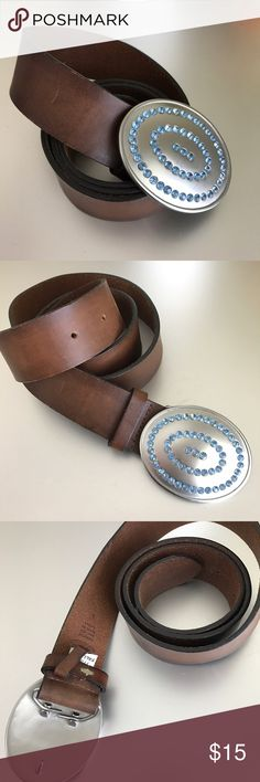 "Brown Leather Belt Genuine leather belt in brown with metal buckle featuring blue gem stones. Band is approx 2"" thick and 39"" long. Excellent condition. Accessories Belts"