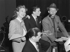 1944: American singers and actors Dinah Shore, Frank Sinatra, and Bing Crosby rehearse a song around a piano in preparation for a radio appearance. An unidentified man sits at the piano.