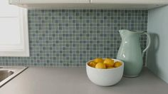 See how simple it is to tile your own backsplash. Follow these tips for a professional look!