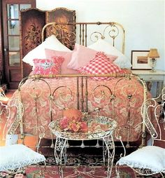 Cathouse Antique Iron Beds - the bed frame is lovely but the rest is too cluttery...
