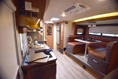 Gallery - Lance 2295 Travel Trailer - Standard exterior kitchen and available interior fireplace set the 2295 apart. Accordion Doors, Fireplace Set, Overhead Storage, Rv Accessories, Shower Rod, Extra Rooms, Counter Space, Travel Trailers, Queen Beds