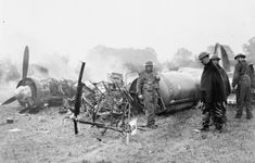 Soldiers guard the smouldering remains of Junkers Ju 88 (W.Nr. 4136: 3Z+BB) of I/KG 77 which crashed at Hertingfordbury, Hertfordshire on 3 October 1940.