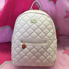 NWT Betsey Johnson Blush Hearts Mini Backpack BETSY JOHNSON *BLUSH Quilted Hearts MINI BACKPACK  FEATURES:  Quilted Heart Design Two compartments Zipper closures Goldtone hardware  Large roomy interior, pink lips lining pink quilted hearts on  pink bottom, no feet MSRP $88 Betsey Johnson Bags Backpacks