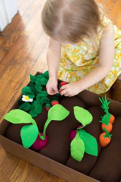 Plantable vege patch.  Great idea for imaginative play.  Use a box with some felt or package filling and then 'plant' your veges.  IKEA have great felt veges for this activity.  Prompt words - 'in'  'push'  'carrot grow'.