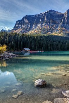 Cabin at Lake Louise in Autumn on a calm morning, Banff National Park, Alberta, Canada by Pierre Leclerc Photography