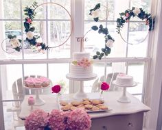 Beautiful dessert table from a Floral 1st Birthday Party via Kara's Party Ideas