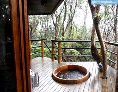 Luxury glamping in Hawaii tree house with hot tub on the balcony