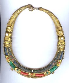 gilt copper torque with inlaid lapis, malachite and coral, pearl 18th c My feeling on these necklaces is that they were actually made for the Chinese court by Mongolians most likely Buriat but are usually categorized as Tibetan. ( Archives sold Singkiang )