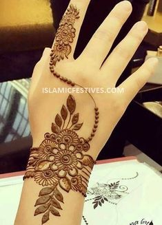 You've got an ocean of henna designs before you, and you can grab your most favorite one. Though it is a small body part, a henna on it looks simple yet elegant. Among all wrist tattoos, henna flower are believed to be the most well-known ones. Henna Hand Designs, Eid Mehndi Designs, Henna Flower Designs, Mehndi Designs Finger, Palm Mehndi Design, Simple Arabic Mehndi Designs, Mehndi Designs For Girls, Mehndi Designs For Beginners, Modern Mehndi Designs