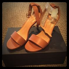 Camel Colored Sandals Heel Measures about 3 1/2 inches. The size says 7 1/2 but it fits 8 to 8 1/2. Runs very large! Beautiful sandals to go with any outfit. I am listing it as an 8 because it will be way too big for a woman that wears a 7 or a 7 1/2 Shoes Sandals
