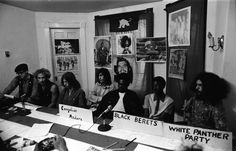 Pun Plamondon of the White Panther Party listens as a member of the Black Berets speaks at a press conference held by Ann Arbor radical groups