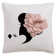 Minnie Mouse Floral Flourish Pillow   Disney Store Even the princess of polka dots likes to change things up once in a while. We think the felted wool appliqué with its hand-stitched embroidered detail captures Minnie's poise and pretty-in-pink presence with perfection.
