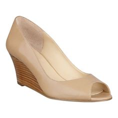 """Peep toe pump on a 2 1/2"""" wedge heel. Features a genuine leather upper on all but camel multi leopard style."""