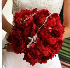 I love this idea...I have a rosary made of the roses from my mom's funeral...what a beautiful photo and way to honor and remember her on my big day :)