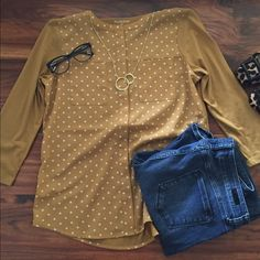 Van Heusen >> Button Up Blouse Mustard yellow polkadot button up with 3/4 sleeves (polkadot pattern is on front of shirt, back of shirt is solid yellow). Front buttons are concealed. True to size. Van Heusen Tops