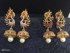 Beautiful jumkhis with dancing peacock design. Jumkhis studded with pink and green color stones. Jumkhi with pearl hangigns.